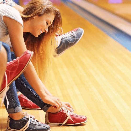 women wearing bowling shoes